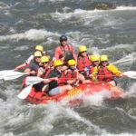 Raft full of people navigating rapids on the Arkansas river