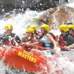 Water splashing on people in a raft on the Arkansas river